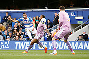 Queens Park Rangers midfielder Matt Phillips (7) has a shot on goal during the Sky Bet Championship match between Queens Park Rangers and Reading at the Loftus Road Stadium, London, England on 23 April 2016. Photo by Andy Walter.