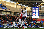 Bolton's Mark Beevers (5) outjumps Charlton's Andrew Crofts (8) during the EFL Sky Bet League 1 match between Bolton Wanderers and Charlton Athletic at the Macron Stadium, Bolton, England on 28 January 2017. Photo by Craig Galloway.