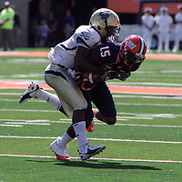 Charleston's Charles James #1 (DB) tackles Illinois Darius Millines #15 (WR) during a play at Memorial Stadium