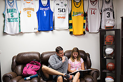 UPike Men's head basketball coach Kelly Wells ,left, helps his daughter Kaylee with her Algebra homework in his office after school, Wednesday, Sept. 24, 2014 at the Eastern Kentucky Expo Center in Pikeville. Photo by Jonathan Palmer, Special to the CJ