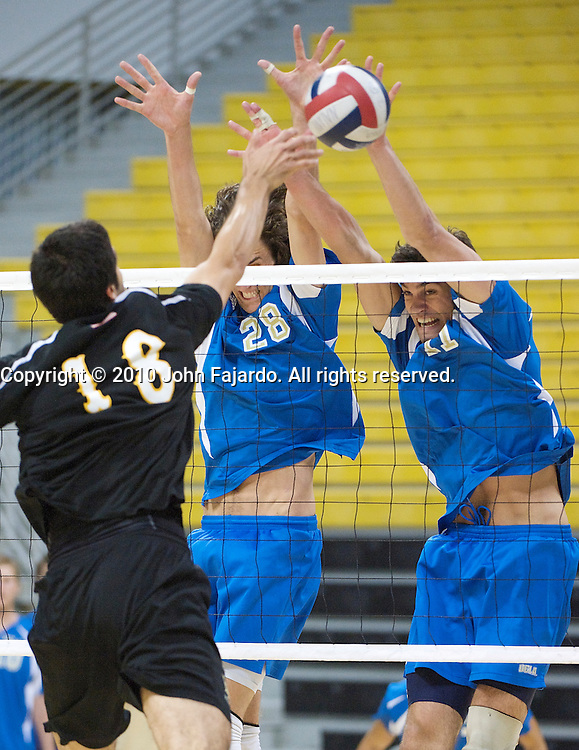 The attack by Dean Bittner(18) is blocked by Nick Vogel(28) and Dylan Bowermaster(17) in the Mountain Pacific Sports Federation match against UCLA at the Walter Pyramid, Long Beach Calif., Friday, April 9, 2010.