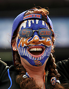 A New York Mets fan wears face paint to cheer her team for Game 1of the National League Division Series baseball game against the Los Angeles Dodgers on Sept. 18, 2006 in New York.