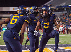 Nov 19, 2016; Morgantown, WV, USA; West Virginia Mountaineers wide receiver Ka'Raun White (2) celebrates with teammates after catching a touchdown pass during the fourth quarter against the Oklahoma Sooners at Milan Puskar Stadium. Mandatory Credit: Ben Queen-USA TODAY Sports