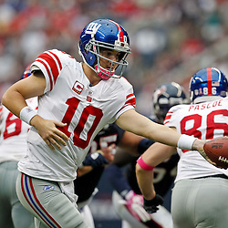October 10, 2010; Houston, TX USA; New York Giants quarterback Eli Manning (10) looks to handoff during the second half of a game against the Houston Texans at Reliant Stadium. The Giants defeated the Texans 34-10. Mandatory Credit: Derick E. Hingle