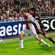 NLD/Amsterdam/20100928 - Champions Leaguewedstrijd Ajax - AC Milan, Siem de Jong  in duel met Gennaro Gattuso