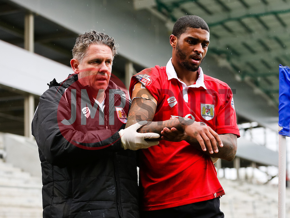 Bristol City's Mark Little walks towards the dug out with a suspected dislocated shoulder - Photo mandatory by-line: Matt McNulty/JMP - Mobile: 07966 386802 - 03/04/2015 - SPORT - Football - Oldham - Boundary Park - Oldham Athletic v Bristol City - Sky Bet League One