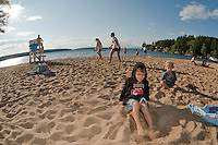 Conner David Chin and Beckett Lehr have some fun digging in the sand at Gilford Beach during the Gilford Parks and Recreations Kick Off to Summer event Wednesday evening.  (Karen Bobotas/for the Laconia Daily Sun)