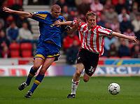 Photo. Richard Lane<br />Southampton v Leeds United. Barclaycard Premiership 19/04/2003.<br />Brett Ormerod (rt) battles with Dominic Matteo