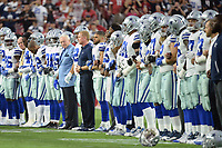 GLENDALE, AZ - SEPTEMBER 25:  Dallas Cowboys owner Jerry Jones and head coach Jason Garrett link arms with their team during that national anthem prior to the NFL game against the Arizona Cardinals at University of Phoenix Stadium on September 25, 2017 in Glendale, Arizona.  (Photo by Jennifer Stewart/Getty Images)