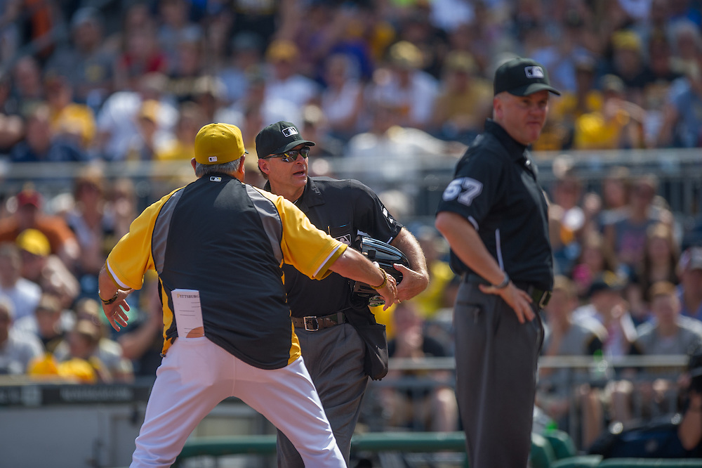 PITTSBURGH, PA - JUNE 08: Clint Hurdle #13 of the Pittsburgh Pirates exchanges emotions with an umpire during the game against the Milwaukee Brewers at PNC Park on June 8, 2014 in Pittsburgh, Pennsylvania. (Photo by Rob Tringali) *** Local Caption *** Clint Hurdle