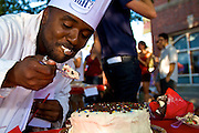 "September 25, 2010 - Claudy Jean-Louise takes a bite of a cake entered in the cooking contest at the 5th Fluff Fest held in Somerville this past Saturday. As he moved down the line to the next dish to judge he exclaimed, ""What should I try next? I love sweets."" Photo by Lathan Goumas."