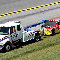 April 17, 2011; Talladega, AL, USA; NASCAR Sprint Cup Series driver Trevor Bayne (21) is towed off following and accident during the Aarons 499 at Talladega Superspeedway.   Mandatory Credit: Derick E. Hingle