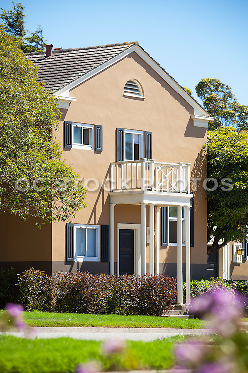 Petite Home Surrounded by Flowers and Shrubs