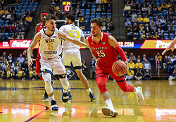 Jan 2, 2019; Morgantown, WV, USA; Texas Tech Red Raiders guard Davide Moretti (25) drives past West Virginia Mountaineers guard Jordan McCabe (5) during the first half at WVU Coliseum. Mandatory Credit: Ben Queen-USA TODAY Sports