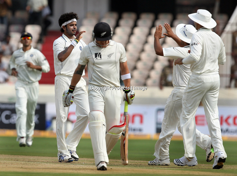 Indian Bowler Sreesanth Celebrates With Team Mates After Take New Zealand Batsman Brendon McCullum Wicket During The 2nd Test Match India vs New Zealand Played at Rajiv Gandhi International Stadium, Uppal, Hyderabad 12, November 2010 <br /> (5-day match)