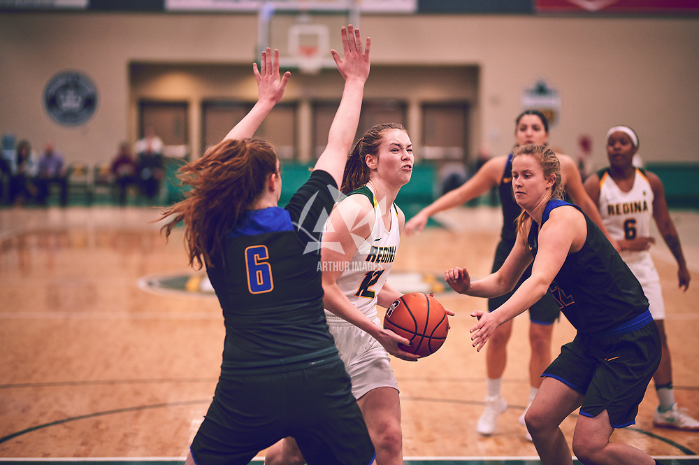 5th year forward, Christina McCusker (12) of the Regina Cougars during the Women's Basketball Home Game on Thu Feb 14 at Centre for Kinesiology,Health and Sport. Credit: Arthur Ward/Arthur Images