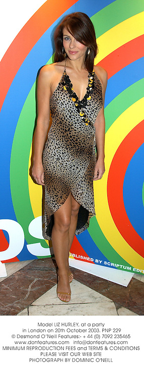 Model LIZ HURLEY, at a party in London on 20th October 2003.PNP 229