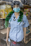 As the Coronovirus pandemic takes hold across the UK, with 53 cases now reported by health authorities, the window of a medical equipment business in south London, a surgical mask is worn by a nurse's mannequin, on 4th March 2020, in London, England.