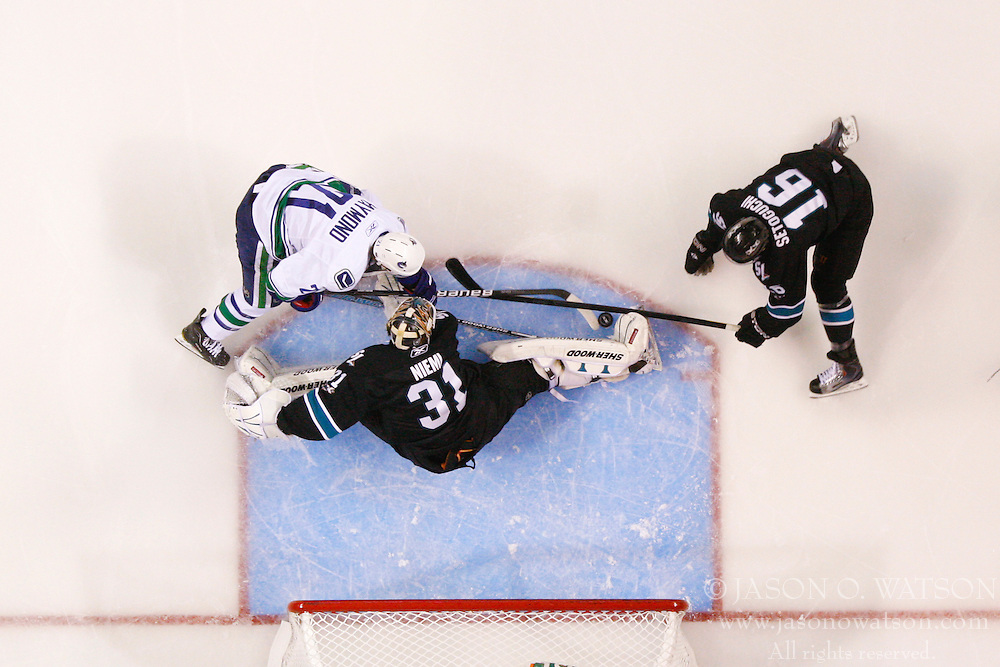 May 22, 2011; San Jose, CA, USA;  San Jose Sharks goalie Antti Niemi (31) stops a shot from Vancouver Canucks left wing Mason Raymond (21) during the first period of game four of the western conference finals of the 2011 Stanley Cup playoffs at HP Pavilion.  Vancouver defeated San Jose 4-2. Mandatory Credit: Jason O. Watson / US PRESSWIRE