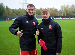 NEWPORT, WALES - Monday, October 14, 2019: Wales' Lewis Collins (L) and Sam Pearson after an Under-19's International Friendly match between Wales and Austria at Dragon Park. Wales won 2-0. (Pic by David Rawcliffe/Propaganda)