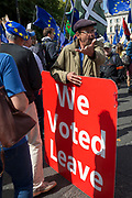 On the day that rebel Conservative Party rebels and opposition MPs attempt to pass a law designed to prevent a no-deal Brexit by the government of Prime Minister Boris Johnson, Brexiteers try to disrupt marching pro-EU Remainers outside Parliament, on 3rd September 2019, in Westminster, London, England.