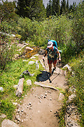 Backpacker on the Big Pine Lakes Trail, John Muir Wilderness, Sierra Nevada Mountains, California USA