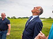03 JUNE 2019 - ANKENY, IOWA: Governor JAY INSLEE, (D-WA), looks up to the top of a wind turbine during a tour at DMACC Monday. Governor Inslee is running to be the Democratic candidate for the US Presidency in 2020, He has made climate change a central point of his campaign and he toured a wind turbine program at the Des Moines Area Community College (DMACC) in Ankeny. Iowa generates more than 35% of its electrical needs through wind power. Iowa traditionally hosts the the first election event of the presidential election cycle. The Iowa Caucuses will be on Feb. 3, 2020.                        PHOTO BY JACK KURTZ