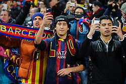 Barcelona fans ecord their side warming up with smartphones before the match  - Photo mandatory by-line: Rogan Thomson/JMP - Tel: 07966 386802 - 18/02/2014 - SPORT - FOOTBALL - Etihad Stadium, Manchester - Manchester City v Barcelona - UEFA Champions League, Round of 16, First leg.