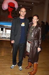 Artist DINOS CHAPMAN and his wife at an opening party for artist Paul McCarthy's exhibition 'LaLa Land Parody Paradise' held at the Whitechapel Gallery, 80-82 Whitechapel High Street, London E1 on 22nd October 2005.<br /><br />NON EXCLUSIVE - WORLD RIGHTS