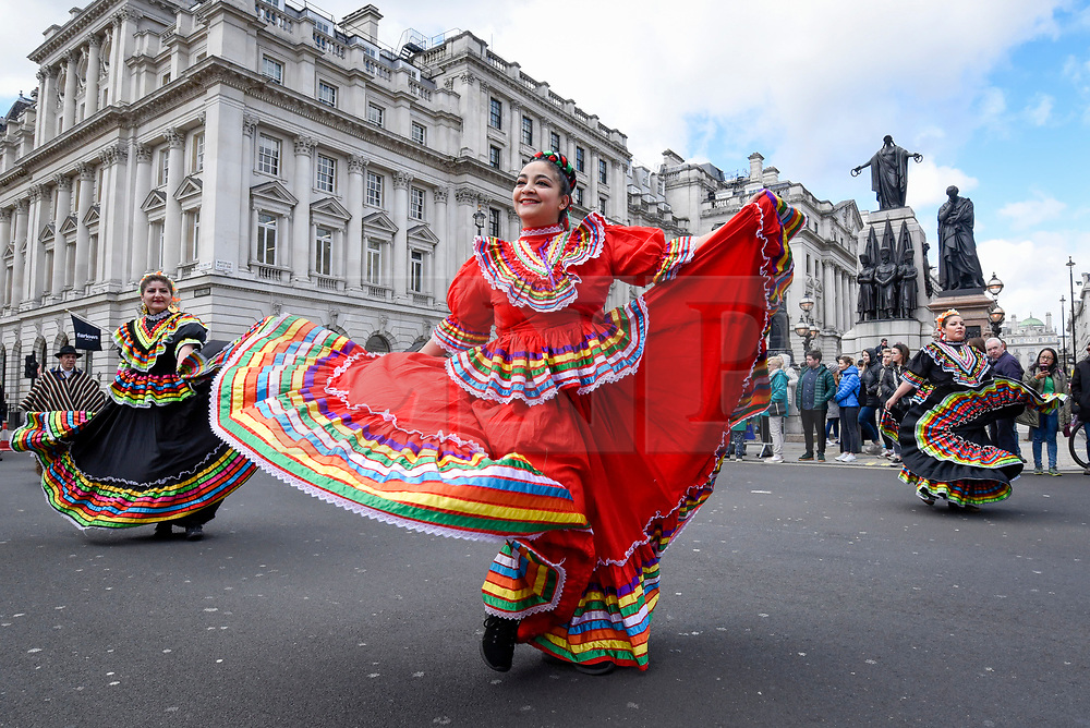 © Licensed to London News Pictures. 17/03/2019. LONDON, UK.  Dancers from a South American dance troupe perform during the annual St. Patrick's Day parade and festival in the capital.  Photo credit: Stephen Chung/LNP