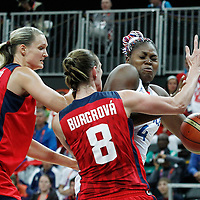 07 August 2012: France Isabelle Yacoubou is fouled by Czech Republic Ilona Burgrova during 71-68 Team France victory over Team Czech Republic, during the women's basketball quarter-finals, at the Basketball Arena, in London, Great Britain.
