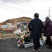 MINAMISANRIKU, JAPAN - MARCH 11: People offer prayers at the memorial site of the Minamisanriku Disaster Emergency Center in Miyagi Prefecture, Japan on March 11, 2017. On this day Japan marks the sixth anniversary of a devastating earthquake and tsunami that hit on March 11, 2011 and left nearly 19,000 people dead or missing, turned coastal communities into wasteland and triggered a nuclear crisis. (Photo: Richard Atrero de Guzman/ANADOLU Agency)