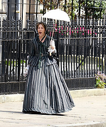 "Moray Place in Edinburgh's Georgian old town was turned into 19th century London for Julian Fellowes' new ITV show ""Belgravia"".<br /> <br /> Pictured: Tamsin Greig (striped dress) can't stop yawning between takes<br /> <br /> Alex Todd 