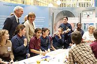 """03 FEB 2004, BERLIN/GERMANY:<br /> Angela Merkel, CDU Bundesvorsitzende, mit Kindern, die am Workshop für Kids """"Elektrizitaet-Magnetismus-Bewegung"""" teilnehmen, Auftaktkongress zum IHK-Jahresthema """"Innovation Unternehmen!"""", Links: Ludwig Georg Braun, Praesident DIHK, Deutscher Industrie- und Handelskammertag, Haus der Deutschen Wirtschaft <br /> IMAGE: 20040203-01-044<br /> KEYWORDS: Innovationskongress"""