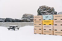 Winter scene from Arnarstapi. Fish boxes in snow at Arnarstapi harbour. Snæfellsnes Peninsula, West Iceland.