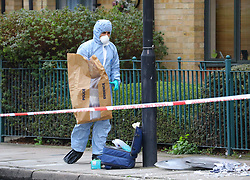© Licensed to London News Pictures. 12/01/2020. London, UK. A Police forensic officer gathers evidence at the crime scene in Upper North Street in Tower Hamlets, where a teenage boy with stab injuries to his chest was discovered and taken to an east London hospital at 3. 30am this morning where he remains in a life threatening condition. A 15-year-old boy has been arrested and taken into custody. Photo credit: Vickie Flores/LNP