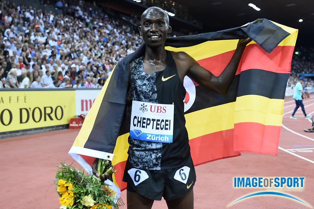 Joshua Cheptegei (UGA) poses with Ugandan flag after winning the 5,000m in 12:57.41 in an IAAF Diamond League final during the Weltkasse Zurich at Letzigrund Stadium, Thursday, Aug. 29, 2019, in Zurich, Switzerland. (Jiro Mochizuki/Image of Sport)