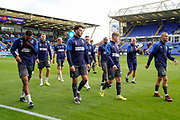 AFC Wimbledon players come of the pitch after warming up during the EFL Sky Bet League 1 match between Peterborough United and AFC Wimbledon at London Road, Peterborough, England on 28 September 2019.