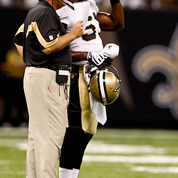August 21, 2010; New Orleans, LA, USA; New Orleans Saints defensive coordinator Gregg Williams talks to linebacker Jonathan Vilma (51) during the first quarter of a preseason game against the Houston Texans at the Louisiana Superdome. Mandatory Credit: Derick E. Hingle