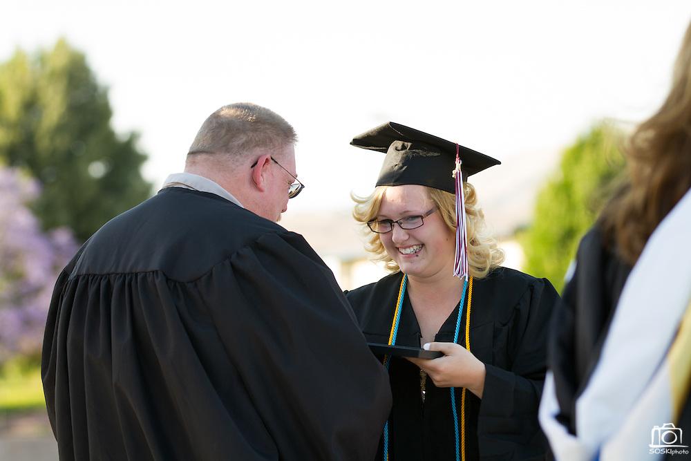 Cal Hills Class of 2012 senior Alexys Dunham accepts the Gladys Fernandes Award, recognizing exemplary school spirit, at graduation on June 15, 2012.  Photo by Stan Olszewski/SOSKIphoto.