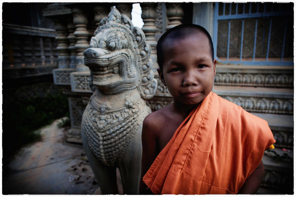 A novice Buddhist monk looks on from his temple in Phnom Penh, Cambodia, Friday, Sept. 14, 2012.