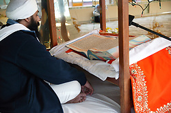 Reading the sacred book at the Sikh Temple,