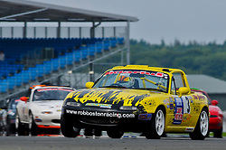 Rob Boston leads the pack through Copse corner at Silverstone in the Ma5da Racing MX5 Championship