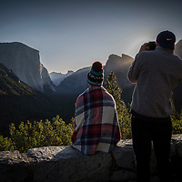 A couple snaps photos during sunrise at Tunnel View inside Yosemite National Park on Sunday, September 22, 2019 in Yosemite, California. (Alex Menendez via AP)