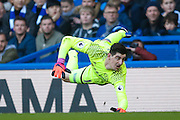 Chelsea goalkeeper Thibaut Courtois (13) watches a shot by harmlessly past the fate post during the Premier League match between Chelsea and West Bromwich Albion at Stamford Bridge, London, England on 11 December 2016. Photo by Simon Davies.