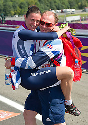 Sarah Story Paralympics Cyclist is hugged by her husband Barney with her gold Medal at Brands Hatch, during the London 2012, Paralympics, Wednesday September 5, 2012. Photo By i-Images..This image can only be used for editorial use.