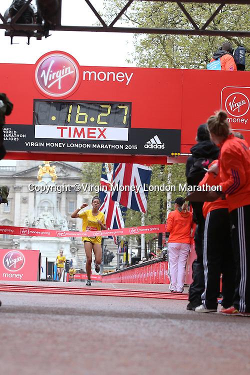 Katy-Ann McDonald of Wandsworth crosses the line to win the Borough Challenge of the Girls U15 race in the Virgin Giving Mini London Marathon, Sunday 26th April 2015.<br /> <br /> Scott Heavey for Virgin Money London Marathon<br /> <br /> For more information please contact Penny Dain at pennyd@london-marathon.co.uk