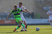 Forest Green Rovers George Williams(11) passes the ball forward during the EFL Sky Bet League 2 match between Forest Green Rovers and Milton Keynes Dons at the New Lawn, Forest Green, United Kingdom on 30 March 2019.