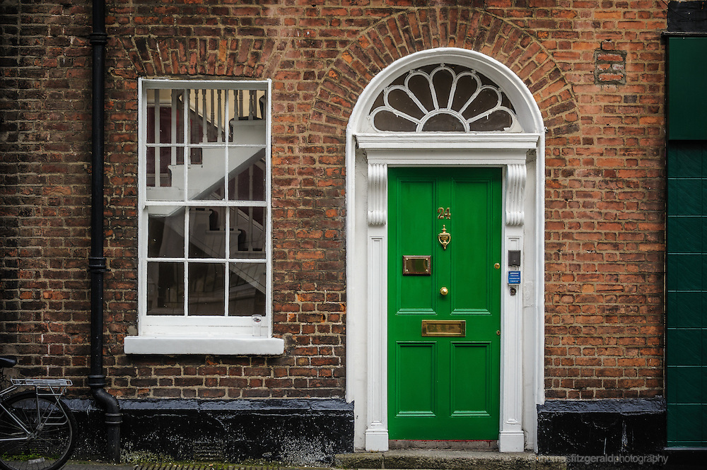 Green door in dublin Wall. Editorial Only