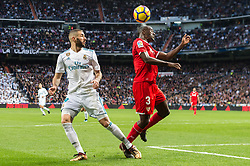 (L-R) Karim Benzema of Real Madrid, Lionel Jules Carole of Sevilla FC during the La Liga Santander match between Real Madrid CF and Sevilla FC on December 09, 2017 at the Santiago Bernabeu stadium in Madrid, Spain.